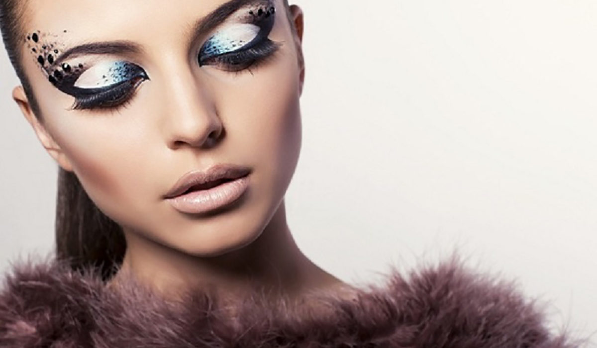 fashion studio photo of beautiful girl with extravagant eyes makeup and fur